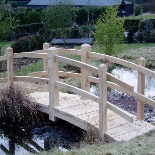 oak-bridge-over-a-pond.jpg