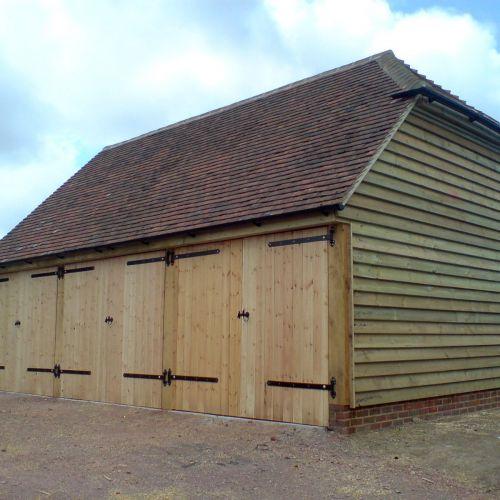 triple-door-oak-framed-garage-kit.jpg